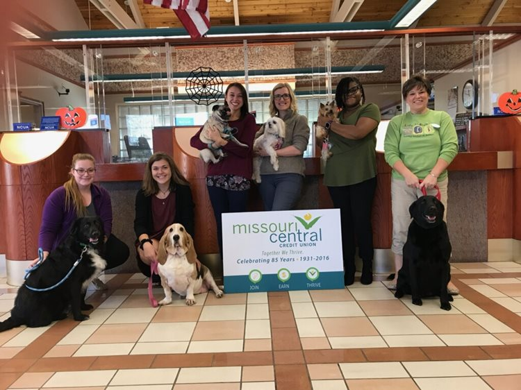 MCCU team holding pets on pet day