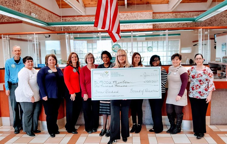 Missouri Central Credit Union Team Holding Big Check